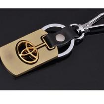 Chaveiro Toyota Em Liga De Metal Dourado E Couro Preto