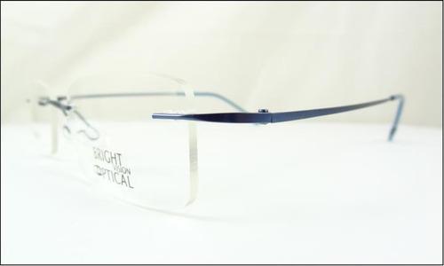 eedfeb6a731d8 Armação Oculos Grau Azul De Feita De Titanium Sem Aro A526