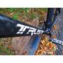 Bicicleta Trust Carbono Manitou R7 Shimano Deore Hidraulico