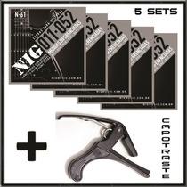 5 Jogos De Cordas 011 Nig Guitarra N61 + Capotraste Pestana