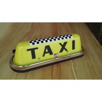 Luminoso Taxi Americano