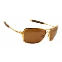 Oculos De Sol Oak Inmate Dourado Polished Gold Polarizado