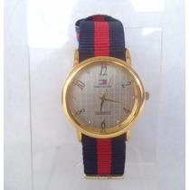 Relógio Fem. Tommy Coroa Redonda Dourada Visor Branco