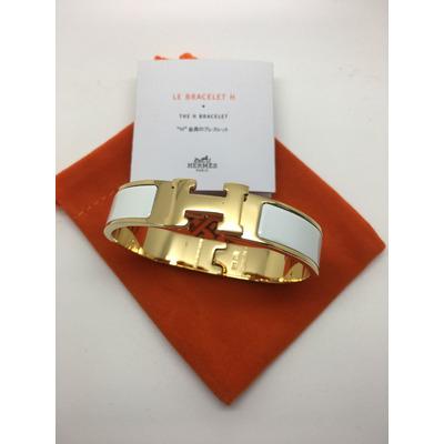 5b21ad7ecc4 Pulseira modelo Clic Clac H Hermès. Cores disponíveis  Branca   Dourado
